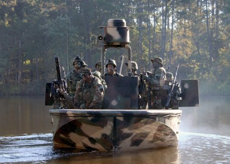 031023-N-3953L-093 Stennis, Miss. (Oct. 23, 2003) - Members of Special Boat Team Two Two (SBT-22) practice narrow river beach extractions under hostile fire conditions. SBT-22Õs primary mission is to conduct special operations in riverine environments. Special Warfare Combatant-craft Crewmen (SWCC) operate and maintain state-of-the-art, high-performance boats and ships used to support Navy SEALs (Sea, Land & Air) and special operations missions. Focusing on clandestine infiltration and extraction of SEALs and other special operations forces, SWCC provide dedicated, rapid mobility in shallow water areas as well as open water environments. U.S. Navy photo by PhotographerÕs Mate 2nd Class Eric S. Logsdon. (RELEASED)